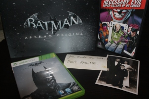 "The Game Disc, Art Book, Black Mask Note, Photo of the Wayne Family, and DVD of ""Necessary Evil"""